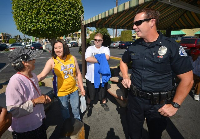 Commander Bill Collins of the Westminster Police Department walks through Phước Lộc Thọ (Phuc Loc Tho) known in English as Asian Garden Mall, the first Vietnamese-American business center in Little Saigon, as he connects with the people who work and visit the community.